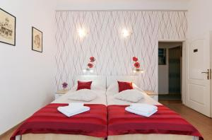 A bed or beds in a room at Guest House Pegla