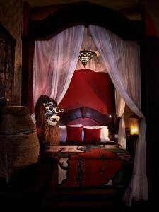 A bed or beds in a room at Tempat Senang Spa Resort & Restaurant
