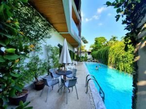The swimming pool at or near Lemonade Phuket Hotel