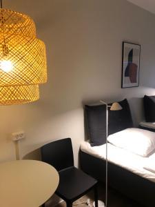 En eller flere senge i et værelse på Harbour Living by Jutlandia