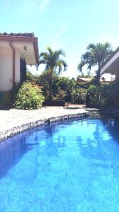 The swimming pool at or near Dos Palmas Studio Apartments