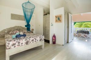 Un ou plusieurs lits dans un hébergement de l'établissement Anoli Lodges Village