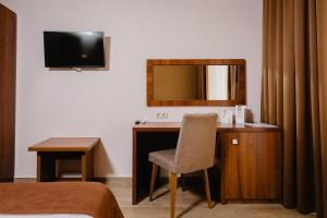 A television and/or entertainment centre at Family Pride inn