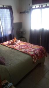 Una cama o camas en una habitación de La Gloria