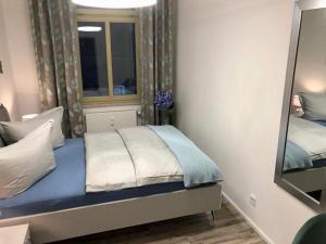 Ein Bett oder Betten in einem Zimmer der Unterkunft Villa Köhler Ferienwohnung