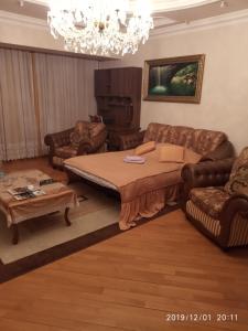Cama ou camas em um quarto em Apartment on Nariman Narimanov 125