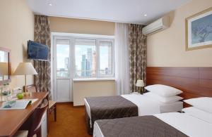 Ein Bett oder Betten in einem Zimmer der Unterkunft Bega Hotel Moscow