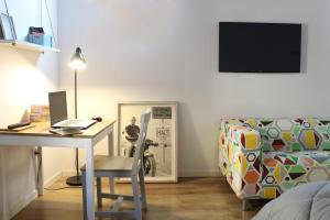 Una televisión o centro de entretenimiento en Casa Puerta de Gazoz