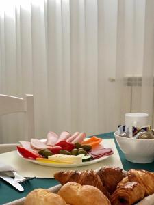 Opțiuni de mic dejun disponibile oaspeților de la London Hotel