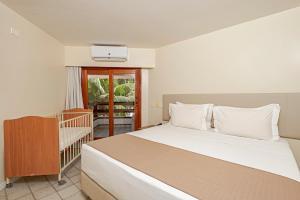 Cama ou camas em um quarto em JATIÚCA SUITES RESORT by Slaviero Hotéis