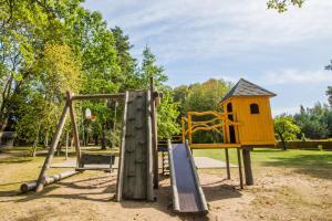 Children's play area at Kempings Usmas Meķi