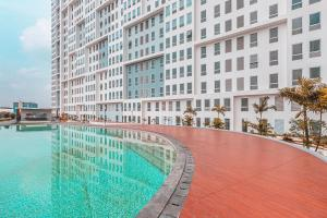 The swimming pool at or close to Collection O 24 Patraland Urbano