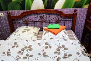 Кровать или кровати в номере Lizy Chaikinoy16