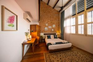 A bed or beds in a room at Sweet Cili Boutique Hotel