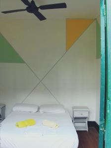 A bed or beds in a room at Freedom Hostel