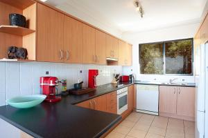 A kitchen or kitchenette at Ocean views and sea breezes over Bondi Beach