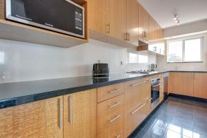 A kitchen or kitchenette at Wake up to Sydney Harbour