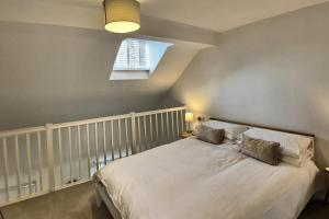 A bed or beds in a room at 52 Minster