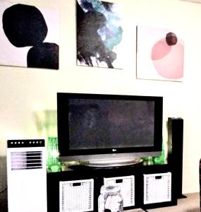 A television and/or entertainment center at Budget beach apartment