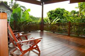 A balcony or terrace at Swiss-Lanna Lodge