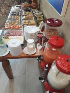 Breakfast options available to guests at Pousada Bahia Bella