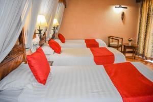 A bed or beds in a room at Lake Nakuru Lodge