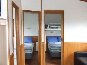 A bunk bed or bunk beds in a room at Western KI Caravan Park & Wildlife Reserve