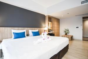 A bed or beds in a room at Days Inn by Wyndham Aonang Krabi