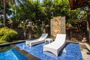 The swimming pool at or close to Legian Village Hotel