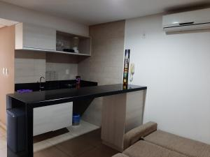 A kitchen or kitchenette at Flat Mar do Cabo Branco Residence