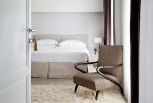 A bed or beds in a room at Riva Lofts Florence