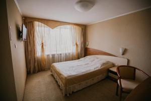 A bed or beds in a room at Hotel Iren