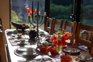 A restaurant or other place to eat at Holiday home on farm (La Ferme du Tao)