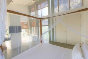 A bed or beds in a room at Villa Amma Erna - Galle