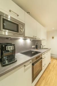 Küche/Küchenzeile in der Unterkunft RHC Central Station Premium Apartments | contactless check-in