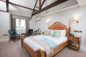 A bed or beds in a room at Wivenhoe House Hotel
