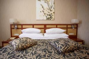 Кровать или кровати в номере Гостиница Альфа Измайлово