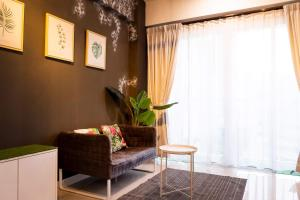 A seating area at Ophelia Suite by D Imperio Homestay Penang