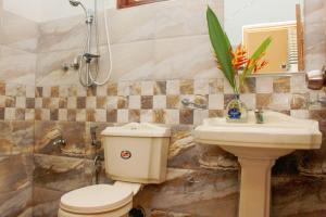 Ein Badezimmer in der Unterkunft Chinuka villa