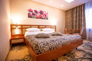 A bed or beds in a room at Izmailovo Alfa Hotel