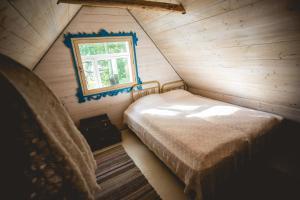 Voodi või voodid majutusasutuse Mesi Tare Guesthouse toas