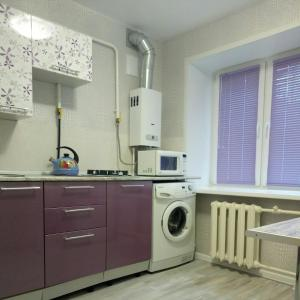 A kitchen or kitchenette at Аппартаменты Куликова