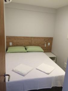 Cama ou camas em um quarto em Lindo Apto 2/4 em Guarajuba