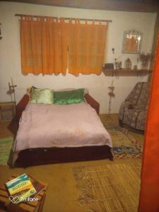 A bed or beds in a room at Chalé Garcia
