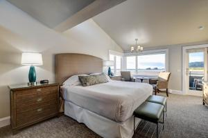 A bed or beds in a room at The Waves