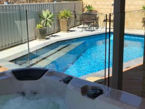 The swimming pool at or near Brighton Beachside HIDEAWAY