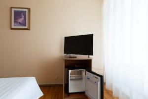 A television and/or entertainment center at A Hotel Amur Bay