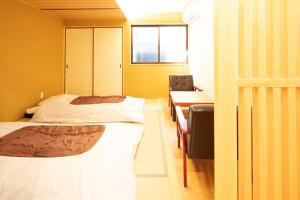 Kamon Inn Toji Michi カモンイン 東寺道にあるベッド