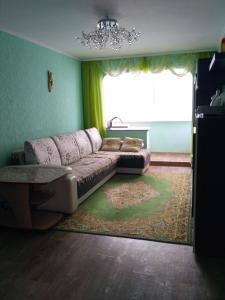 A seating area at 2 Bedrooms apartment on Gagarina
