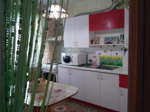 A kitchen or kitchenette at 2 Bedrooms apartment on Gagarina